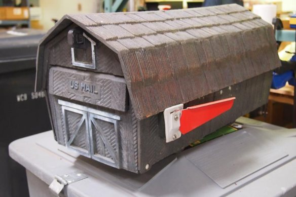 Old mailbox shaped like a barn
