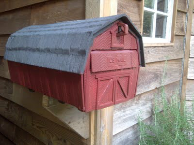 A base coat of barn red paint.